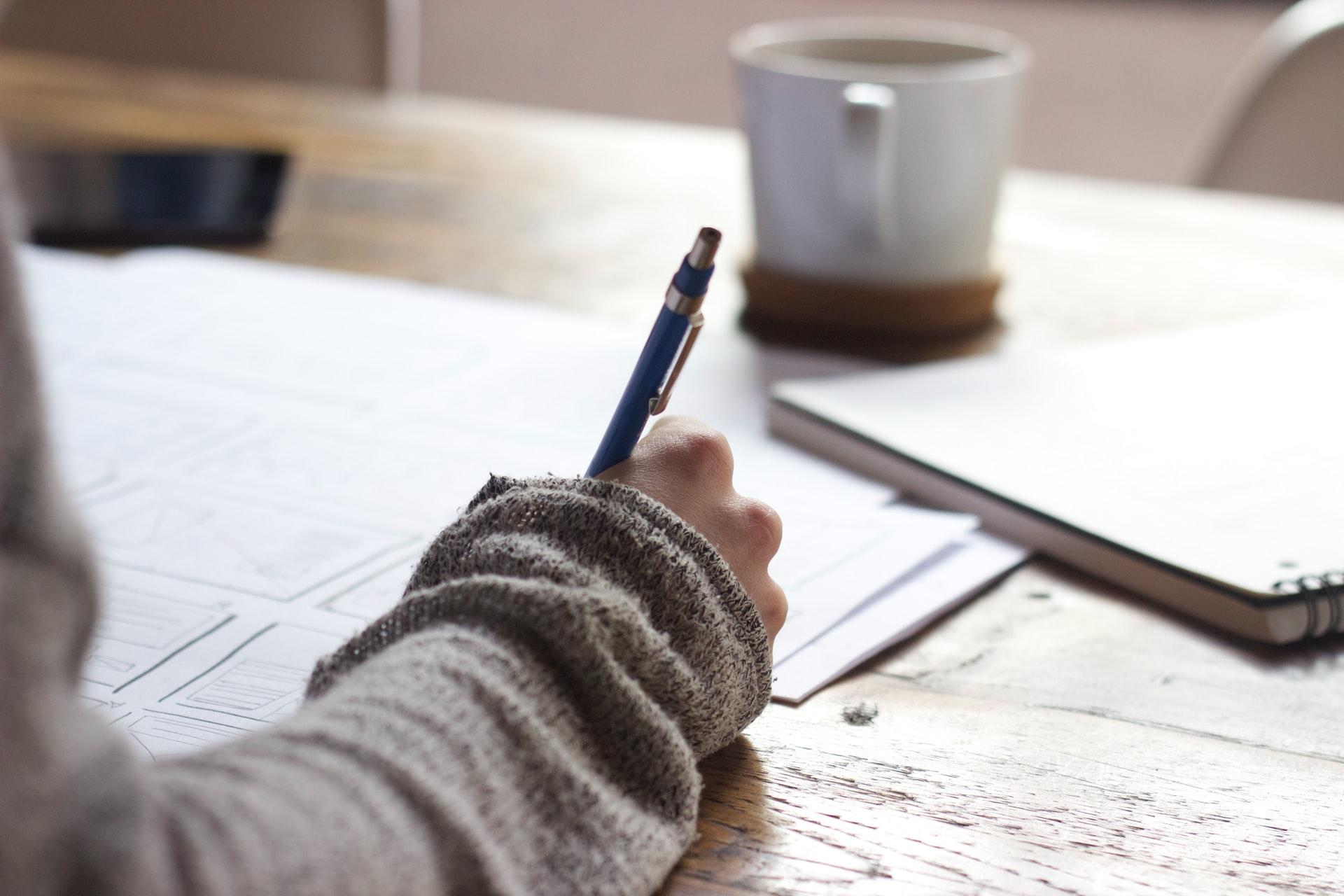 Writing. Photo by Green Chameleon on Unsplash.