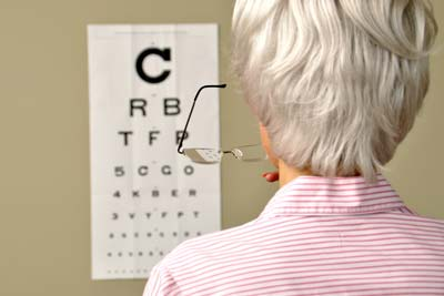 Woman reading Snellen eye chart